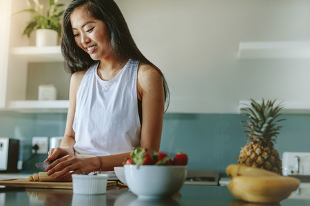 Female making healthy breakfast after workout