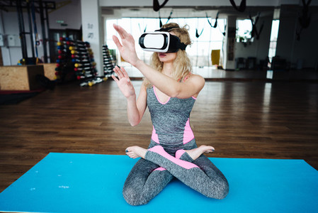 Woman in yoga class with VR headset