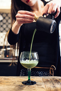 Pouring green tea Matcha cocktai