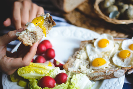 Quail eggs on bread with butter