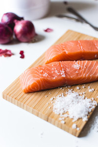 Raw salmon fillets prepared