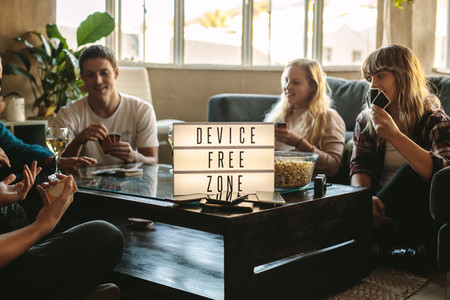 Digital detox   Friends playing cards at device free zone
