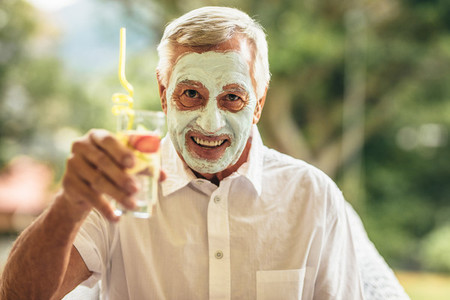 Man having spa facial treatment at retired age