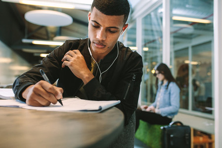 Student preparing for exams at university library
