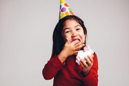 Close up of a kid enjoying candy floss
