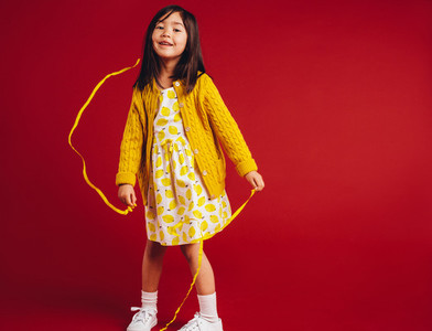 Kid having fun playing with decorative ribbons