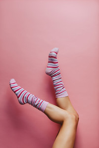 Woman feet in multicolored striped socks