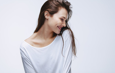 Beautiful woman in white top smiling