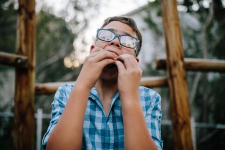 Portrait of a boy eating sandwich
