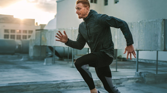 Fitness man doing workout on rooftop