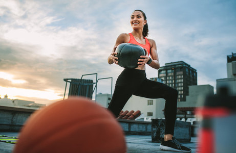 Fitness woman doing workout using a medicine ball