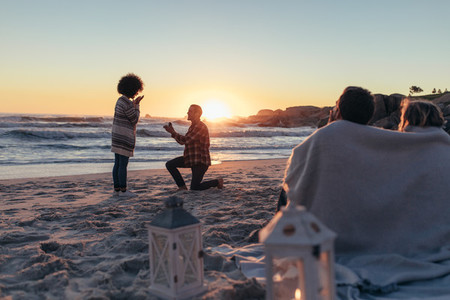 Marriage proposal at sunset beach
