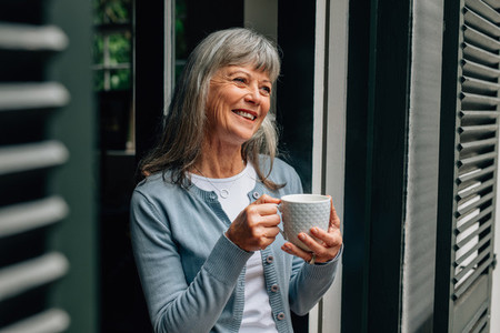 Portrait of a senior woman holding a coffee cup