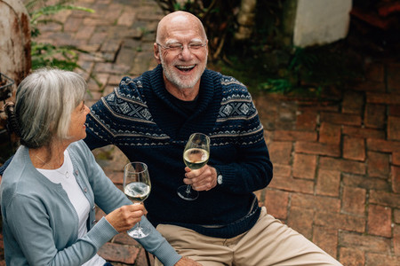 High angle view of a senior couple drinking wine
