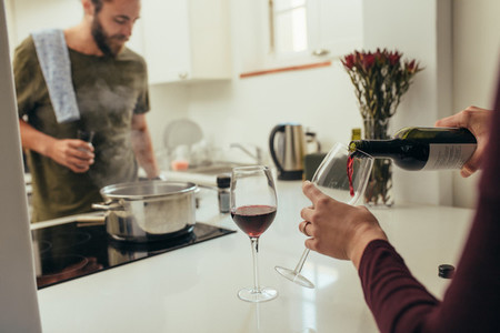 Couple making dinner arrangements at home