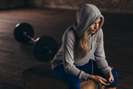 Woman taking break after workout at gym