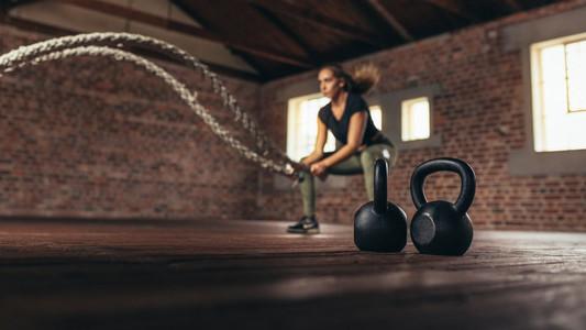 Female cross training at fitness club