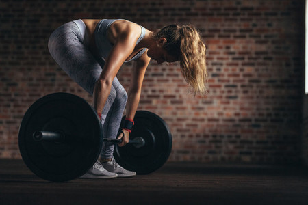 Determined fitness woman training with heavy weights