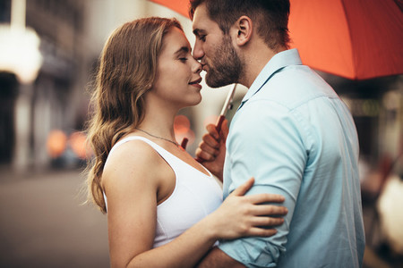 Couple standing on street embracing  each other
