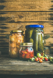 Autumn pickled vegetables in glass jars copy space