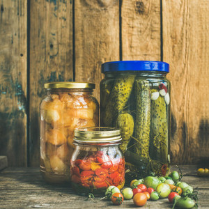 Autumn pickled vegetables in jars  copy space  square crop