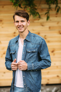 young handsome man in a denim shirt