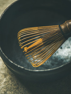 Close up of traditional Japanese Chasen whisk and dark bowl