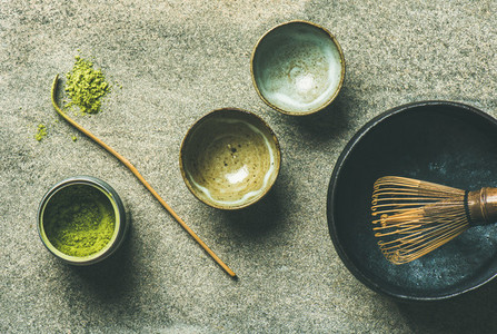 Japanese tools for brewing matcha tea grey background top view