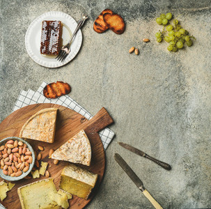 Flat lay of platter with cheese assortment and snacks  copy space