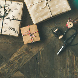 Flat lay of gift boxes rope fur branches scissors square crop