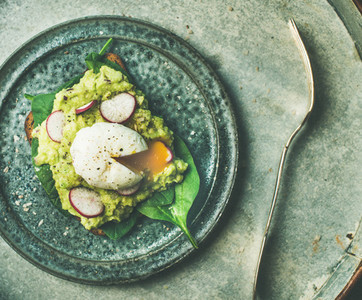 Healthy vegetarian wholegrain avocado toasts with poached egg  top view
