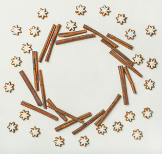 Christmas wreath made from cookies and cinnamon sticks copy space