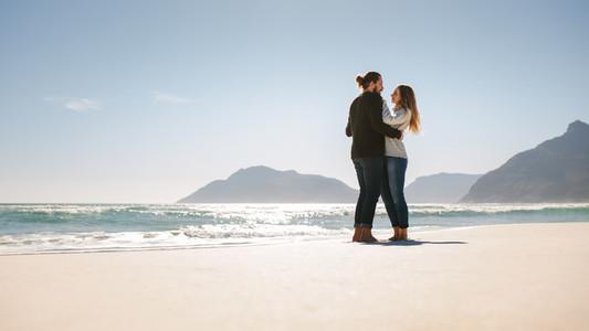 Romantic couple on the sea shore