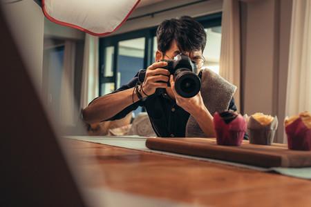Food photographer shooting in his studio