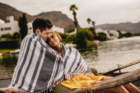 Couple sitting in a boat on a romantic date