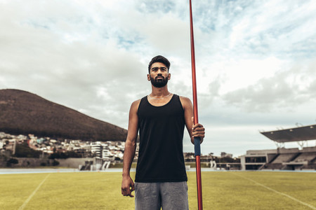 Athlete standing holding a javelin