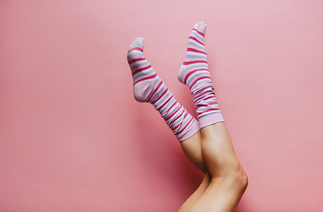 Female legs in colourful striped socks