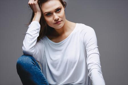 Beautiful woman with hand on head