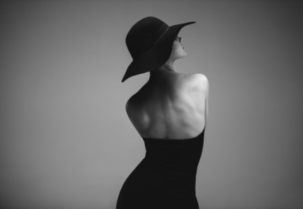 Elegant woman in black dress and hat