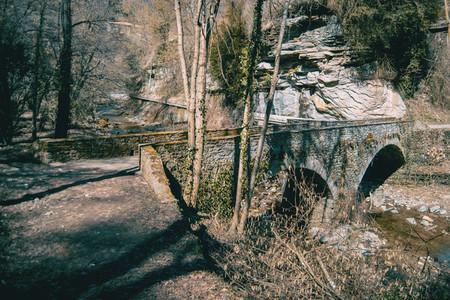 An ancient bridge crossing a river