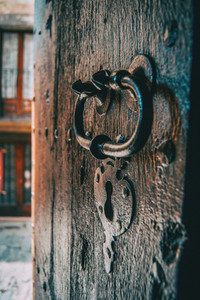 A lock and a handle of a medieval wooden door