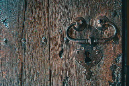 Detail of a lock and a handle of a wooden medieval door