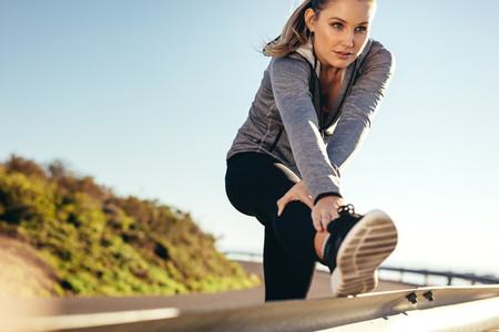 Fitness woman doing workout on road