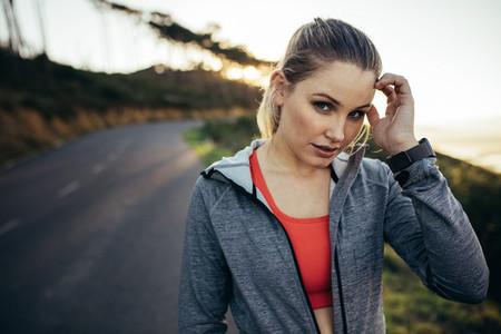 Fitness woman standing on street in the morning
