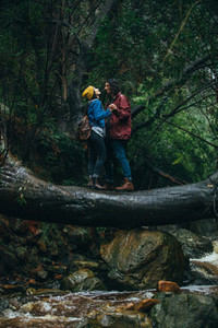 Couple enjoying in rain at the forest