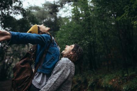 Romantic couple enjoying the rain
