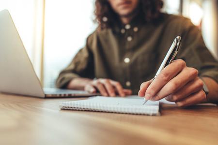 Entrepreneur making notes at his desk