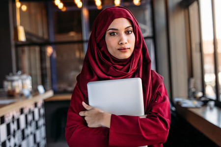 Islamic businesswoman in hijab at coffee shop