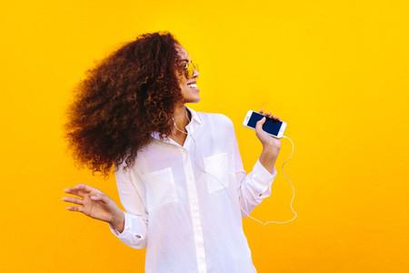 African girl enjoying listening music