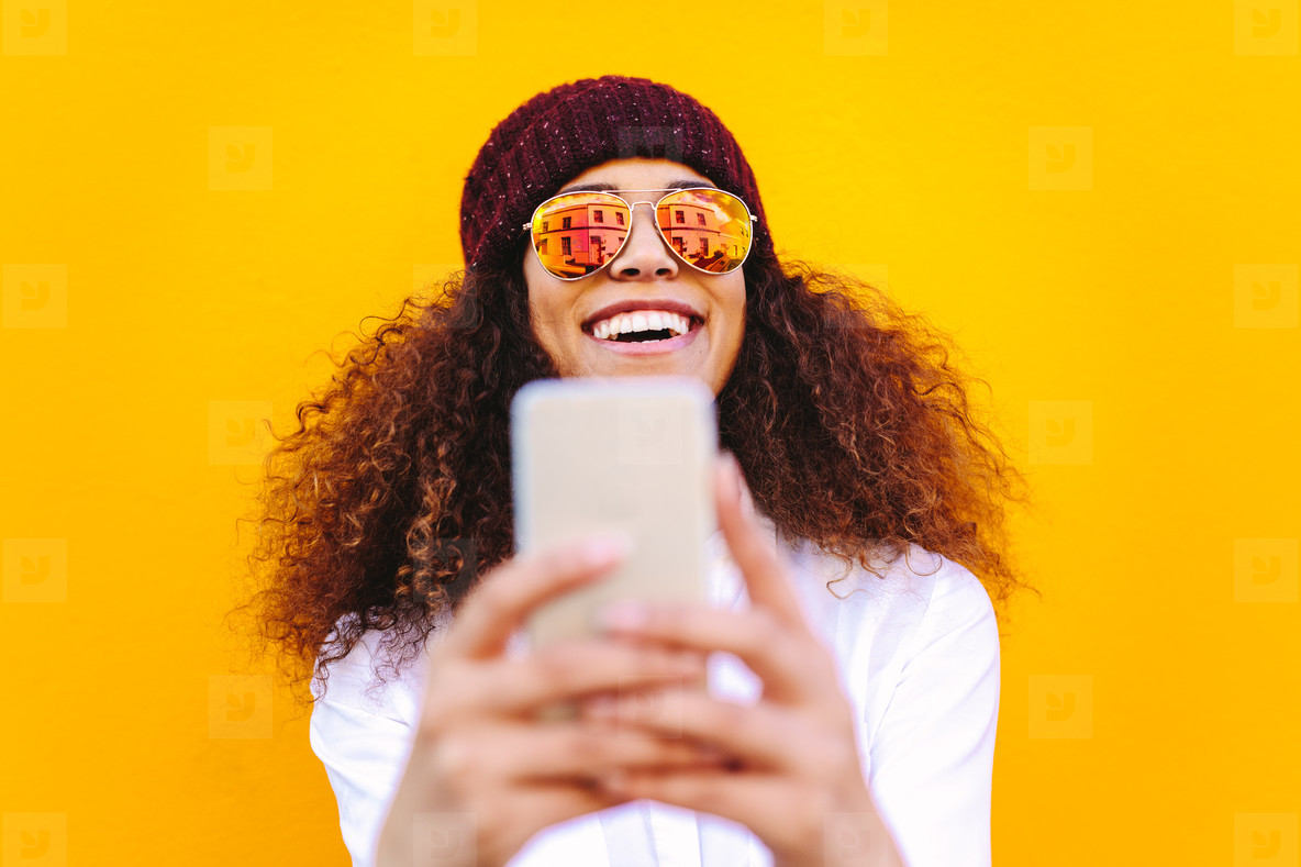 Stylish african woman making selfie